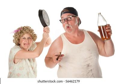 Woman readies a pan to drunken husband's head
