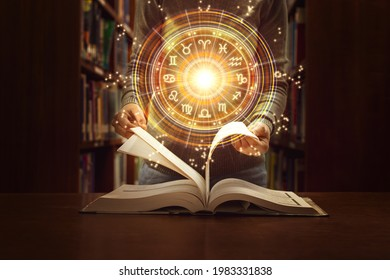 Woman reading a astrology book. Astrological wheel projection, choose a zodiac sign. Trust horoscope future predictions, consulting stars. Power of universe, astrology esoteric concept.