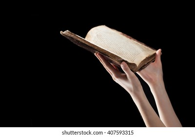 woman reading the bible in the darkness