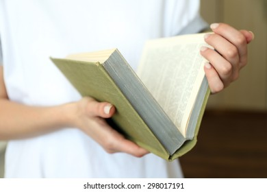 Woman reading book in room