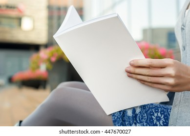 Woman reading a book in shallow focus