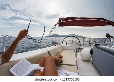 Woman reading a book while cruising on the boat. concept about technology relaxation vacations and transportations