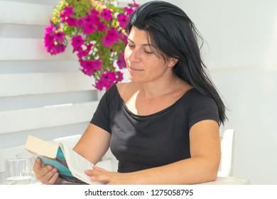 Woman reading at a coffee store. A relaxing moment.