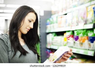 Woman reading description on the box