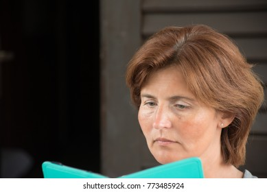 A woman reading the electronic book
