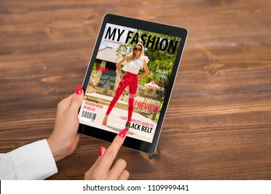 Woman reading emagazine on tablet. All contents are made up.
