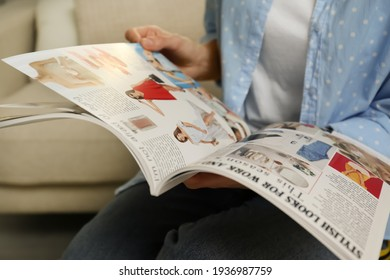 Woman reading fashion magazine indoors, closeup view
