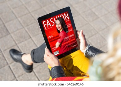 Woman reading fashion magazine on tablet
