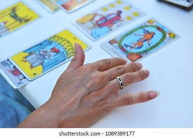 Woman reading the future and fortune in tarot cards
