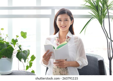 Woman reading her book