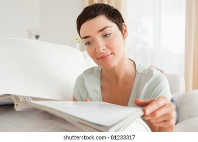 Woman reading a magazine in her living room