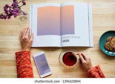 Woman reading a magazine mockup
