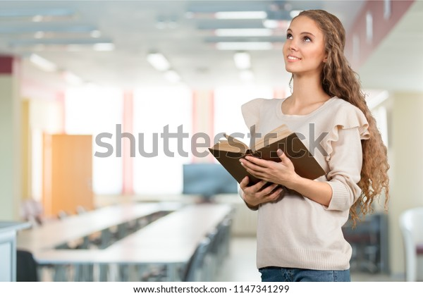 Woman reading old heavy book