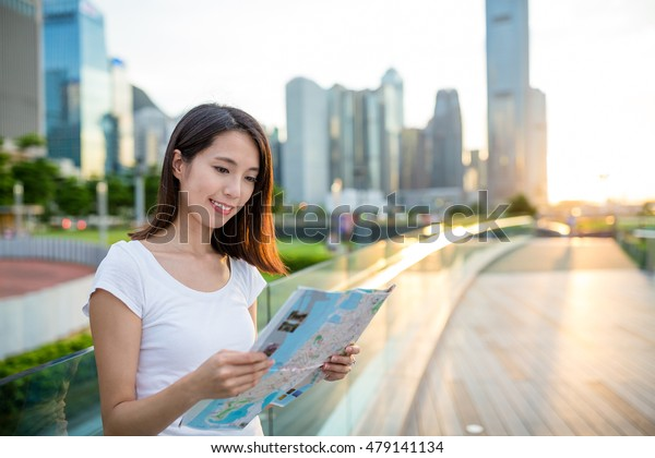 Woman reading on paper map