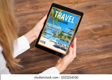 Woman reading travel magazine on tablet