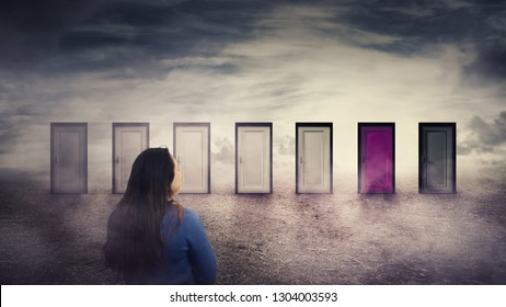 Woman rear view in front of many doors choosing one different colored. Difficult decision, important choice concept, failure or success. Ways to unknown future, business career development opportunity