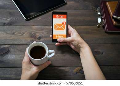 The woman received an e-mail online on a mobile phone. Message online icon