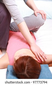 woman receives chiropractic