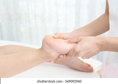 Woman receives leg massage at spa salon