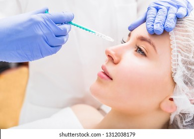 Woman receiving beauty plastic injection on her nose