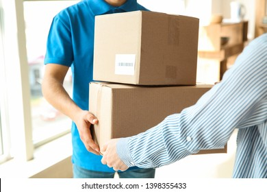 Woman receiving boxes from delivery man