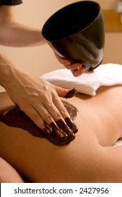 woman receiving cacao therapy in a spa