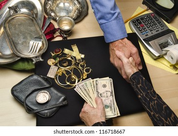 woman receiving cash for gold and silver items