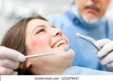 Woman receiving a dental treatment