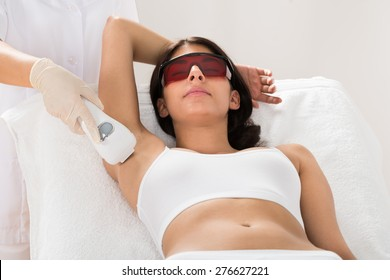 Woman Receiving Epilation Laser Treatment On Armpit At Beauty Clinic