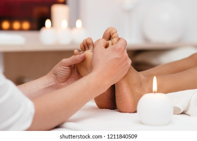 Woman receiving a foot massage at the health spa