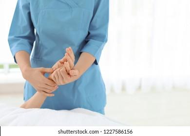 Woman receiving hand massage in wellness center