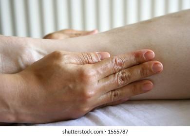 A woman receiving a holistic massage treatment