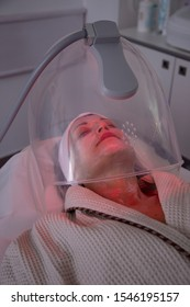 Woman receiving LED facial therapy for face