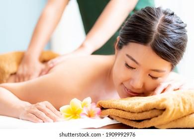 Woman receiving massage in Bali