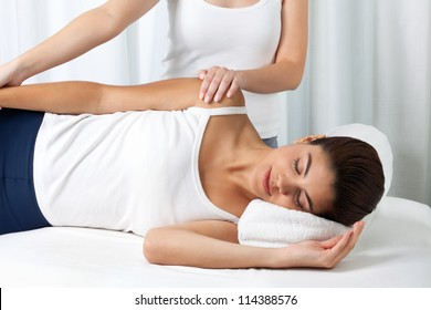 Woman receiving a massage in spa.