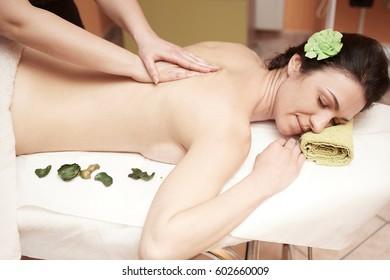 A woman receiving a massage at spa salon