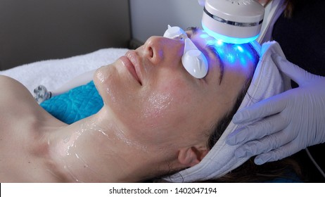 Woman receiving a Microcurrent LED Facial, also known as natural, non-invasive face lift, tightening skin and promoting rejuvenation.