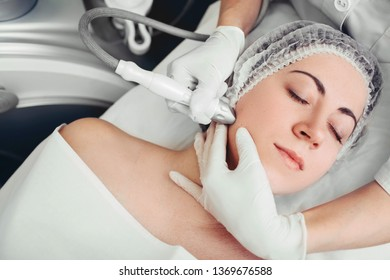 woman receiving no-needle high frequency mesotherapy at beauty salon. non-invasive procedure for skin rejuvenation