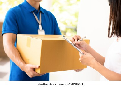 Woman receiving package from  a delivery man