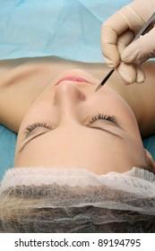 A woman receiving a plastic operation, closeup