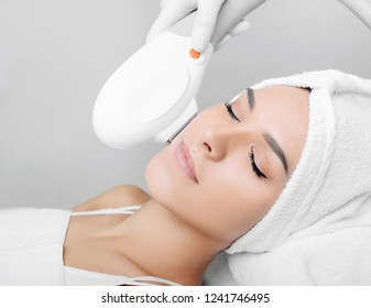 woman receiving procedure, skin rejuvenation at beauty salon. Elos procedure removes brown spots and narrows pores , smoothens fine wrinkles, slows down the age-related changes in skin