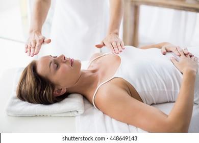 Woman receiving Reiko treatment at spa