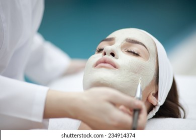 Woman receiving spa treatment