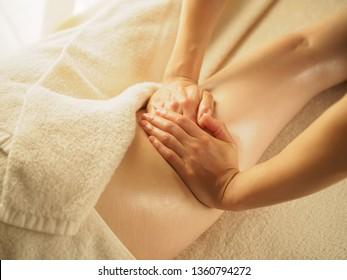 Woman receiving a thigh massage