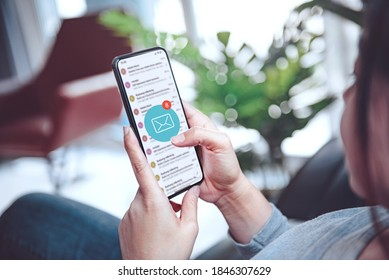 Woman recieve inbox view the pending e-mail communication at home, New messages on mobile smartphone at home.