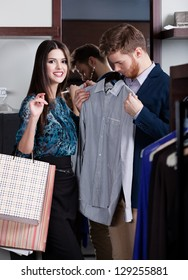 Woman recommends the shirt to her boyfriend at ready-made clothes shop