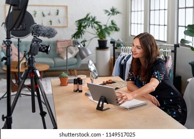 Woman recording content for her lifestyle blog vlog, modern businesswoman using social media for marketing