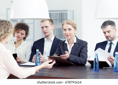 Woman from recruitment committee asking questions about candidate's resume