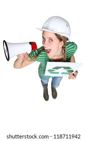 Woman with recycle poster shouting into megaphone