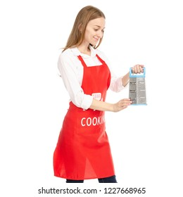 A woman in a red apron in the hands kitchen grater on a white background. Isolation